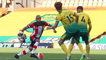 Nathan Redmond of Southampton scores his sides 3rd goal during the Premier League match at Carrow Ro