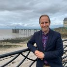 James Cridland of Coleridge Wealth Management in front of Clevedon Pier and beach
