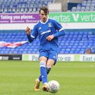 Liam Gibbs has completed his Norwich City move from Ipswich Town