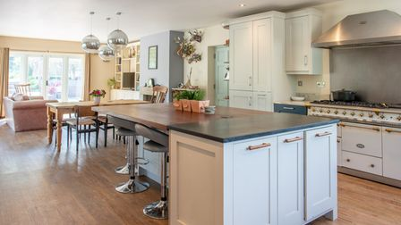 The open-plan living area is very much the hub of the home, featuring a kitchen space with central b