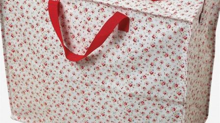 The distinctive floral-patterned laundry bag used by the male suspect