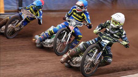 Paul Starke charges up the inside of James Wright and Kyle Howarth in heat eight.