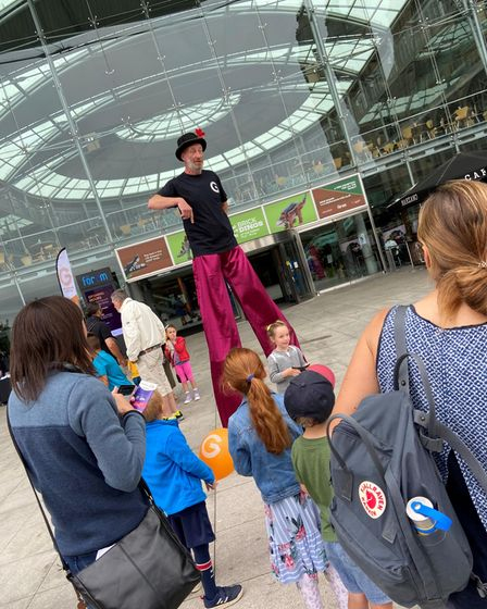 Stilt walker at The Garage's Turn Your Dreams Into Reality day of events