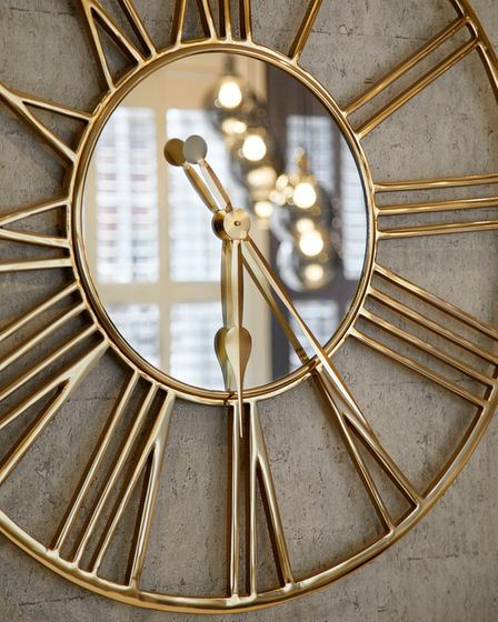 Brushed brass clock used to accessorise and decorate a wall, designed by Juliettes Interiors in Chelsea.