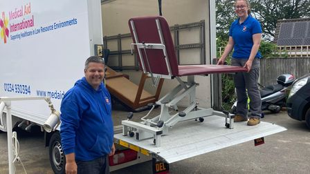 Amy Philpot and Ed Grefe from Medical Aid International picking up the donated items fromCromer Vets.