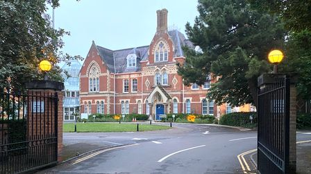 A brick building in the evening: Uttlesford District Council's offices, known as The Council Offices, Saffron Walden, Essex