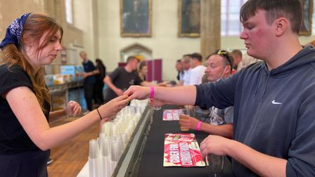 People enjoying the Sausage and Cider Fest in Norwich's St Andrew's Hall.