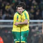 Tom Trybull of Norwich, Timm Klose of Norwich and Christoph Zimmermann of Norwich at the end of the