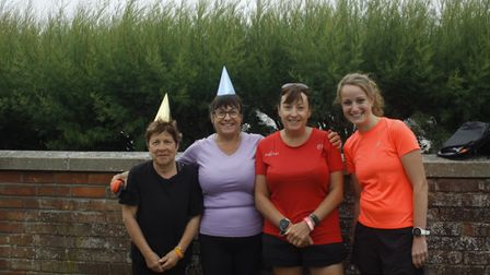 Runners wearing party hats at the start of the Felixstowe parkrun