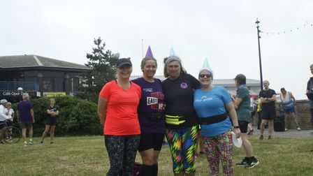 Runners in party hats at the start of the Felixstowe parkrun