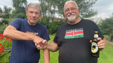 Nigel Cairne, left, with Colin Knight, right, who met at the Copdock village fete
