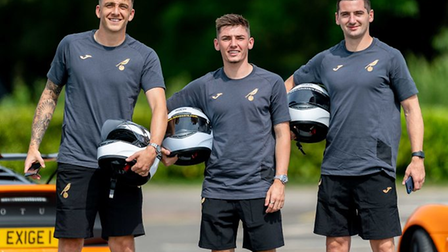 Norwich City stars Jordan Hugill, Billy Gilmour and Kenny McLean at a Lotus track day. Picture: Norwich City