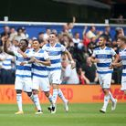 Queens Park Rangers' Moses Odubajo (left) celebrates scoring their side's third goal of the game dur
