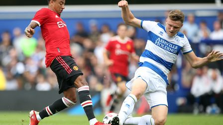 Manchester United's Jesse Lingard (left) and Queens Park Rangers' Rob Dickie battle for the ball dur