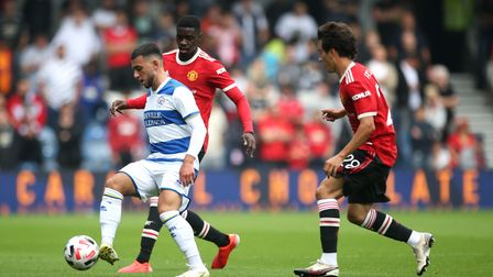 Queens Park Rangers' Ilias Chair and Manchester United's Facundo Pellistri and Axel Tuanzebe (left-r