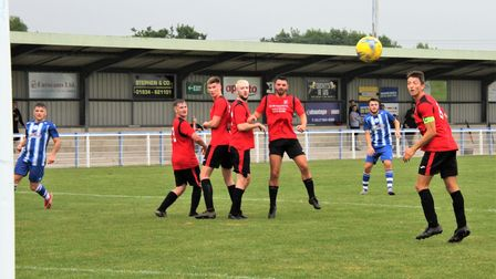 Ethan Feltham fires home a free-kick for Clevedon Town against Clevedon United