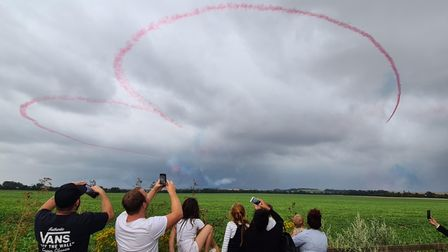 Two RedArrows jets making the famous 'heart' symbol with their smoke trails at the Duxford Summer Air Show.