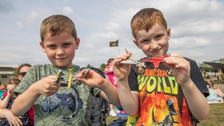 Young aviation enthusiasts at the Duxford Summer Air Show at IWM Duxford.