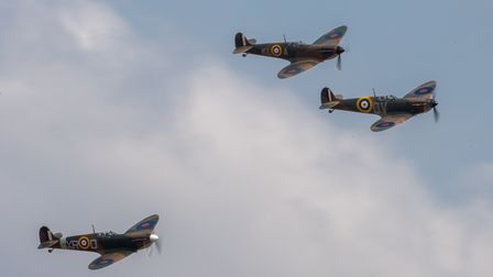 Three Spitfire Mark Is, led by IWM's own Spitfire N3200, fly in formation at the Duxford Summer Air Show at IWM Duxford.