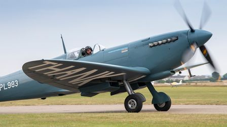 Pilot John Romain prepares for take off at the Duxford Summer Air Show in the 'NHS Spitfire'