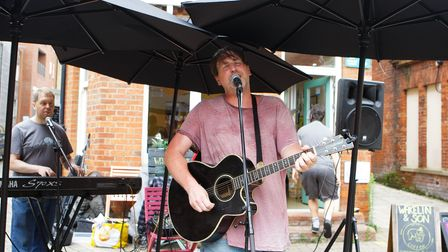 The Scallywags perform outside Wakelin & Son in Hitchin forBucklersbury and Sun Street Dayahead of their Club 85 gig