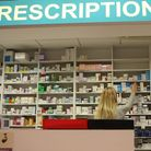 A pharmacist stocks shelves at a chemist in Dublin as Health Minister Mary Harney was urged to be ca