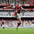 Arsenal's Calum Chambers jumps for the ball during the Premier League match at the Emirates Stadium,