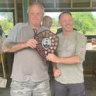 Andy Law receives the Dave Fowler Memorial Match shield from Barry Fowler