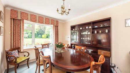 The dining room is one of the Harpenden property's four reception rooms.
