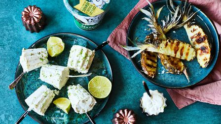 Ice-cream on sticks, with pieces of pineapple on a blue table cloth