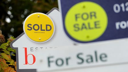 File photo dated 14/10/14 of sold and for sale signs. House sales jumped to record levels in June as