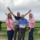 Mel Shields (centre) completed the skydive on his 81st birthday to support Ashfields Care Home.