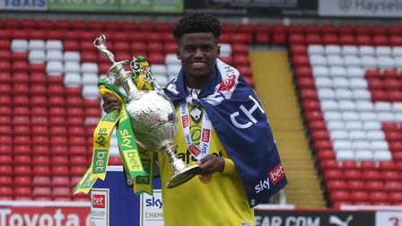Bali Mumba of Norwich with the EFL Championship trophy at the end of the Sky Bet Championship match