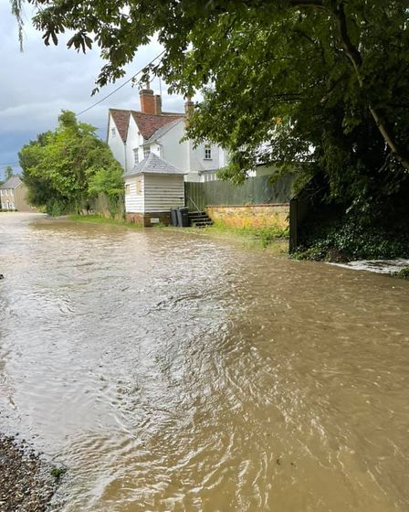 A road in Helions Bumpstead which looks more like a river.