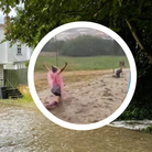 Background: Helions Bumpstead flooded. Inset: Festival-goers on a Standon Calling mudslide