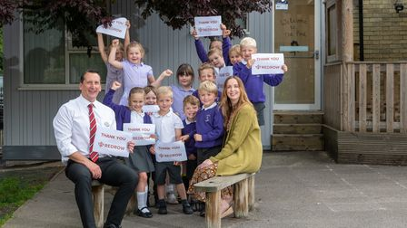Redrow sales assistant Nigel Clay with pupils from Therfield First School and headteacher Tara McGovern