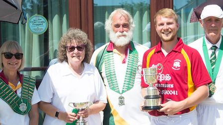 Bowls players with trophies