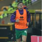 Reece McAlear of Norwich warms up during the Sky Bet Championship match at Carrow Road, Norwich Pic