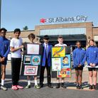 Members of St Albans Arts Society with pupils from Heathlands School