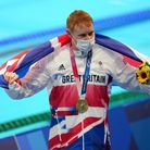Great Britain's Tom Dean with his gold medal celebrates after winning the Men's 200m Freestyle at To