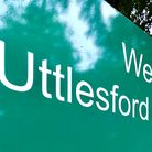 """""""Uttlesford District Council"""" on a green sign at the London Road offices, Saffron Walden"""
