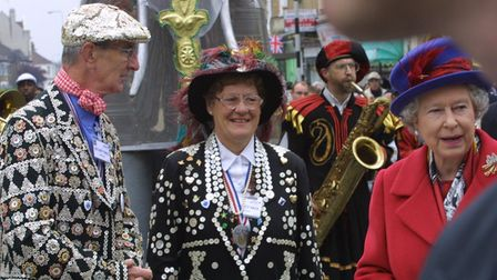 The Queen with Newham's Pearly King and Queen George Davison and Angela in Green Street during Her M
