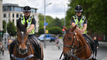 Police on horseback during a Black Lives Matter protest rally. Photograph: Ben Birchall/PA.