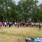 Pre-run briefing;parkrunners distanced and listening intently.