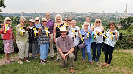 Norfolk Day Shardlake's Norwich tour pictured on Kett's Heights with tour guide Paul Dickson kneeling