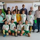 Queens Park Sharks under-10s face the camera