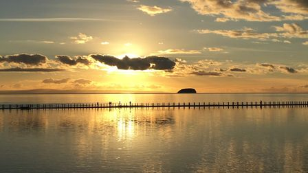 yellow-toned sunset at Marine Lake and Knights Causeway in Weston-super-Mare