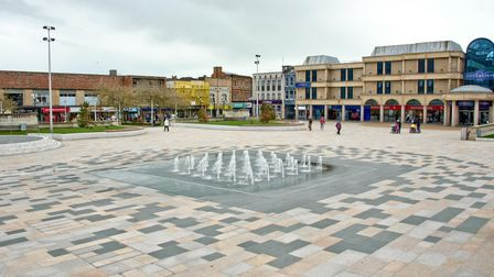 The dancing fountains in the multi-coloured paved Italian Gardens in Weston, with the Sovereign Shopping Centre behind.