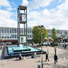 People and shops in the central square in Stevenage town centre Hertfordhshire UK showing th