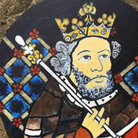 A painting of King Cnut as if he were on a stained-glass window in Hadstock, Essex - He wears a crown and holds a staff.